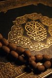 Holy Koran book & rosary. Close up of Holy Koran book & rosary Royalty Free Stock Images