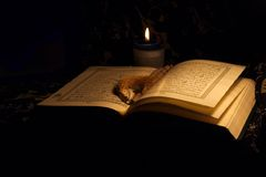 Holy Koran book & rosary. Close up of Holy Koran book pages Stock Photography