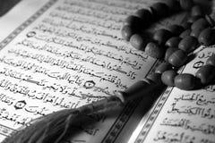 Holy Koran book & rosary Stock Images