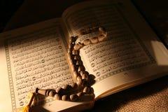 Holy koran &  rosary Stock Image