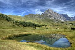 Holy lake and the Odle, Dolomites - Italy. Reflected in the holy lake near the Odle, Dolomites mountains - Italy stock photos