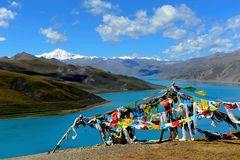 Holy lake and prayer flags Royalty Free Stock Photography