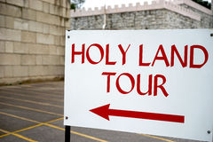 Holy Land tour sign - points left. Many people travel to the historical holy land of their religion. A visit is central to their faith Stock Photo