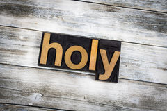 Holy Letterpress Word on Wooden Background Stock Photos