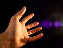 Holy light. Hand, hold in to the light Royalty Free Stock Photography