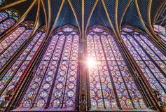 Holy light in the Chapel. Beautiful stained glass of the Sainte-Chapelle (Holy Chapel), a royal medieval Gothic chapel in Paris, France, on April 10, 2014 Royalty Free Stock Photography