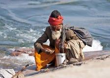 Holy Man Guru on rock along Betwa River. Stock Image