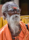 Holy man or Sadhu with glasses. Stock Photos