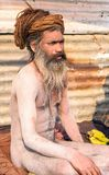 Holy man sits inmeditation during Kumbha Mela Royalty Free Stock Images
