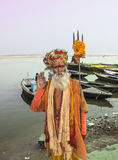 Holy man in Varanasi. A holy man or sadhu on the ghats of the holy city of Varanasi Stock Photography