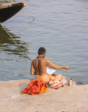 Holy man in Varanasi. A holy man or sadhu is reciting loudly from a book on the ghats of the holy city of Varanasi Royalty Free Stock Image