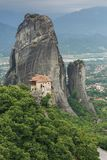 Holy Monastery of Rousanou or St. Barbara, Meteora, Kalambaka town in distance Stock Image