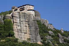 The Holy Monastery of Rousanow - Meteora, Greece. Estern Orthodox monastery bulit on natural sandstone rock pilar Stock Photo