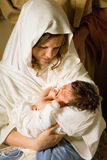 Holy mother with Christmas. Living christmas nativity scene reenacted with a real 18 days old baby Royalty Free Stock Photography