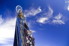 Holy Mother of Jesus. Holy Mother statue over a beautiful cloudy sky Royalty Free Stock Photos