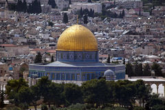 Dome of the Rock. The holy Muslim Dome of the Rock and the houses in old Jerusalem, behind the old Jerusalem surrounding city wall, as seen from Mount of Olives Royalty Free Stock Image