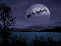 Holy Night. Santa Claus is flying in the dark sky Stock Image