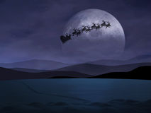 Holy Night. Santa Claus is flying in the dark sky Stock Photo