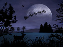 Holy Night. Santa Claus is flying in the dark sky Royalty Free Stock Photography