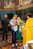 The Holy Orthodox rite of the sacrament of baptism newborn baby Stock Image