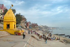 Holy Place In India. A yellow colour temple on a ghat by the banks of the Ganga (Ganges) river in Varanasi, India Stock Photo