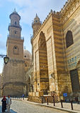 The holy places in Al-Muizz street. CAIRO, EGYPT - OCTOBER 10, 2014: The high minarets covered with carved islamic patterns are the proud of Al-Muizz street in Stock Image
