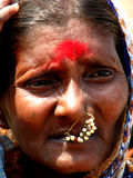 Holy Powder. An old Indian lady wearing the red holy powder on her forehead Royalty Free Stock Photography