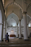 Holy prayer by Indian-Muslim in Penang mosque. Great architecture, geometric shape, interior of a Indian-Muslim mosque, praying Stock Photos