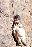 holy man. Holy man sitting in front of recessed church in lalibela ethiopia Stock Photos