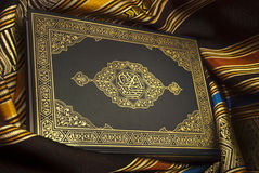 The holy Quran. The Noble Qur'an is the verbatim word of the god (Allah) according to the muslims believes, it is the central religious text book of islam Stock Images