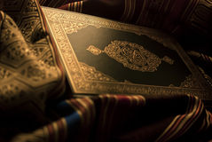 The holy Quran. The Noble Qur'an is the verbatim word of the god (Allah) according to the muslims believes, it is the central religious text book of islam Stock Photos