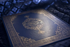 The holy Quran. The Noble Qur'an is the verbatim word of the god (Allah) according to the muslims believes, it is the central religious text book of islam Stock Image