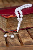 Holy Quran with beads Stock Photos