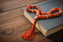 Holy Quran with beads Stock Photo