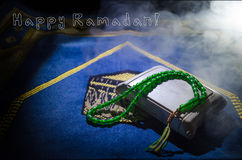 Holy Quran with beads on a prayer mat, Muslim Tasbih is a string of prayer beads which is traditionally used by Muslims along with Royalty Free Stock Images