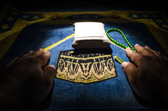 Holy Quran with beads on a prayer mat, Muslim Tasbih is a string of prayer beads which is traditionally used by Muslims along with Royalty Free Stock Photos