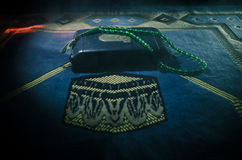 Holy Quran with beads on a prayer mat, Muslim Tasbih is a string of prayer beads which is traditionally used by Muslims along with Stock Photography