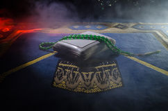 Holy Quran with beads on a prayer mat, Muslim Tasbih is a string of prayer beads which is traditionally used by Muslims along with Stock Photos