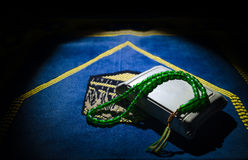Holy Quran with beads on a prayer mat, Muslim Tasbih is a string of prayer beads which is traditionally used by Muslims along with Royalty Free Stock Photo