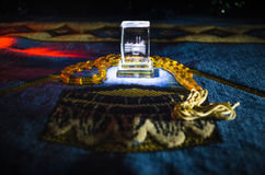 Holy Quran with beads on a prayer mat, Muslim Tasbih is a string of prayer beads which is traditionally used by Muslims along with. The Quran. Ramadan holidays Stock Image