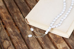 Holy Quran with beads Stock Images