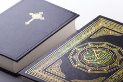 The Holy Quran and Bible. A close up shot of both holy books the Quaraan and Bible next to each other Stock Images
