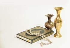 Holy Quran book and antique vases royalty free stock photos