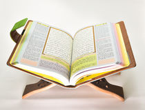 The holy Quran. The Quran is the central religious text of Islam, which Muslims believe to be a revelation from God. It is widely regarded as the finest work in Stock Image
