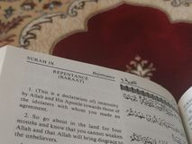 The Holy Quran in English and Arabic on a beautiful Eastern-Pattern Styled Rug stock photo