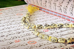 Holy Quran And Rosary. Arabic Ramadan Fasting Aya From Holy Quran And Rosary stock photography