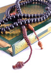 The Holy Quran with rosary Stock Image