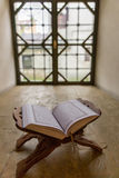 Holy Quran in window niche. At backlight stock image