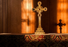 Holy reflection. A Christian cross casting a shadow on the back of the alter Stock Photo