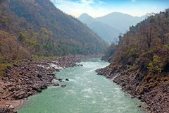 The river Ganges in India at Laxman Jhula. The holy river Ganges in India at Laxman Jhula Stock Photos